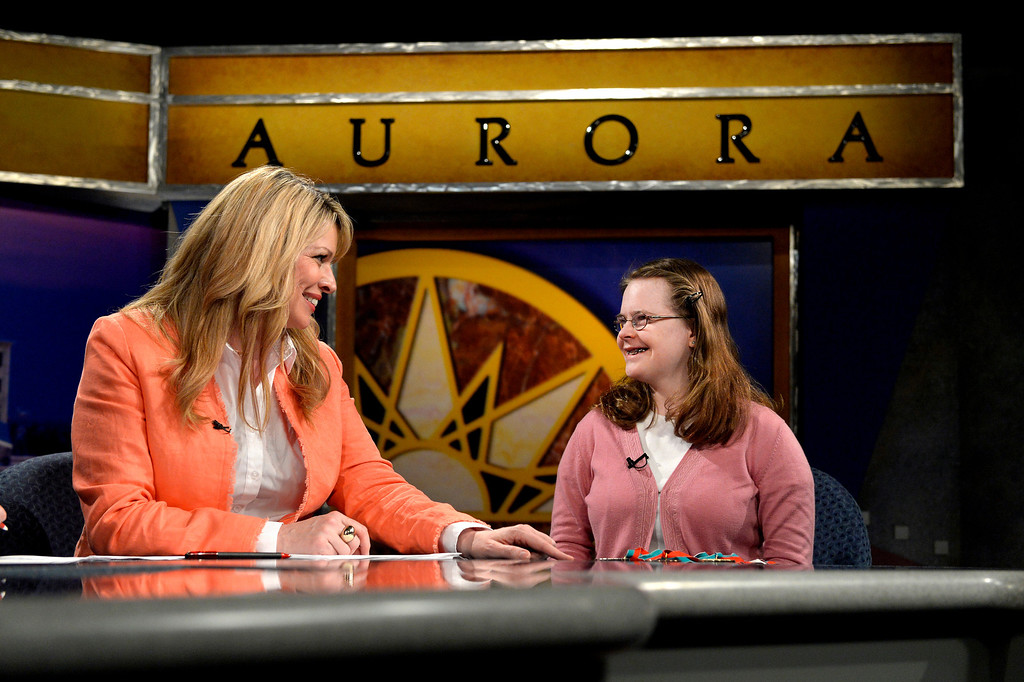 . AURORA, CO. - FEBRUARY 18: (l-r) Anchor  Wendy Brockman talks with guest Hanna Atkinson during the taping of Aurora News Weekly in Aurora, CO February 18, 2014. The 30 minute news show is part of Aurora 8\'s public access programming. Atkinson was invited to talk about participating in the upcoming Special Olympics (Photo By Craig F. Walker / The Denver Post)