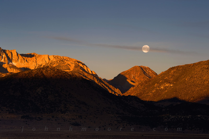Bisected moon at sunrise