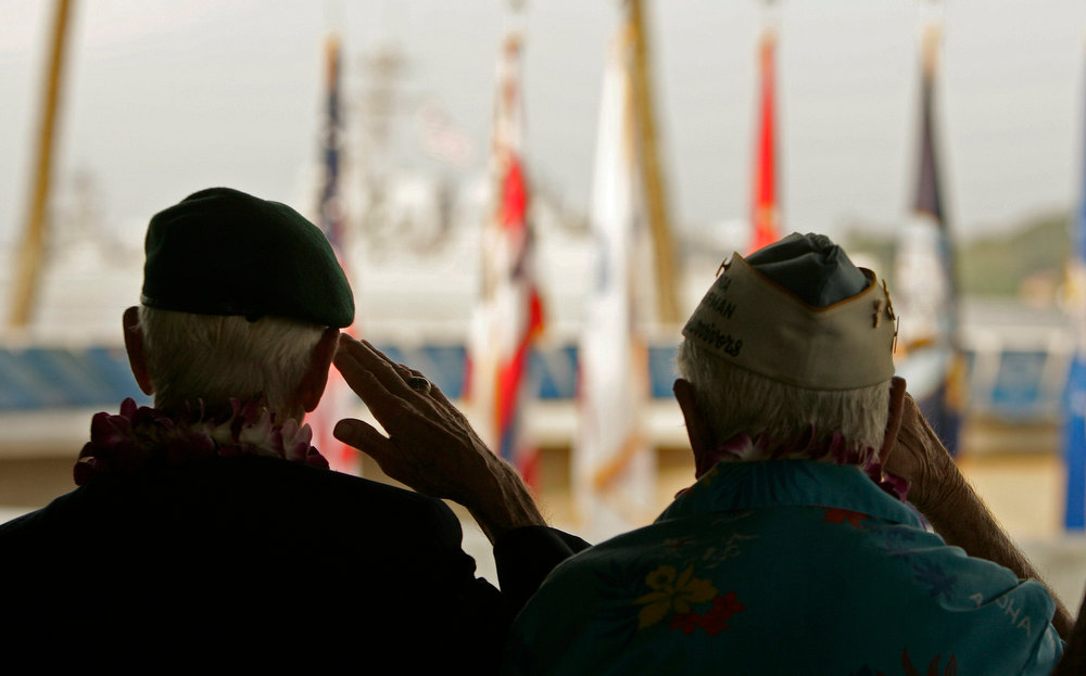 Description of . Pearl Harbor survivors Albert Broom (L) and Sterling Cale salute as the USS Michael Murphy passes the USS Arizona Memorial at the 71st anniversary of the attack on Pearl Harbor at the  WW II Valor in the Pacific National Monument in Honolulu, Hawaii December 7, 2012. REUTERS/Hugh Gentry