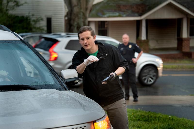 Davidson police help ease the traffic as Wes Fogg takes an order. (Bill Giduz photo)