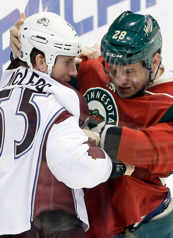 . Colorado Avalanche\'s Cody McLeod, left, and Minnesota Wild\'s Zenon Konopka go at it in the first period of an NHL hockey game Saturday, Jan. 19, 2013 in St. Paul, Minn. Both received fighting majors and Konopka a minor penalty for interference. (AP Photo/Jim Mone)