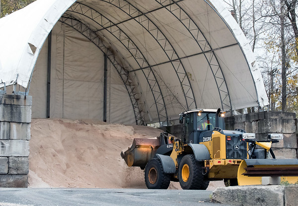 11/15/18 Wesley Bunnell | Staff New Britain Public Works trucks were being prepped and loaded with salt in anticipation of the upcoming winter storm schedule to hit New England Thursday evening into Friday. A front loader picks up a load of salt for waiting plow trucks.