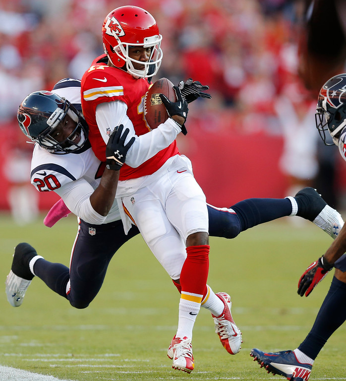 . Kansas City Chiefs wide receiver Donnie Avery (17) is tackled by Houston Texans free safety Ed Reed (20) during the first half of an NFL football game at Arrowhead Stadium in Kansas City, Mo., Sunday, Oct. 20, 2013. (AP Photo/Ed Zurga)