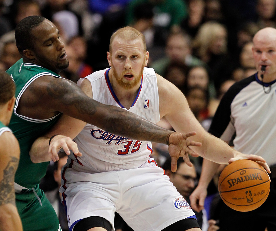 . Boston Celtics forward Glen Davis (11) reaches out to swipe at the ball under control by Los Angeles Clippers center Chris Kaman (35) during the first half of an NBA basketball game, Saturday, Feb. 26, 2011, in Los Angeles. (AP Photo/Alex Gallardo)