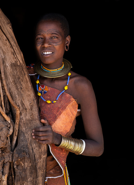 Young Datoga woman with the traditional tattoo and scarification around her eyes.  Tanzania, 2019