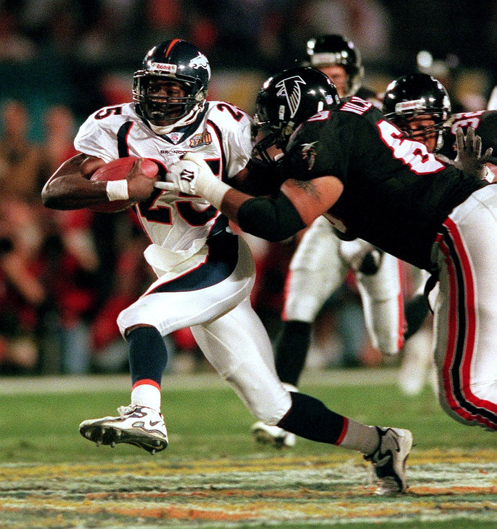 . Denver Broncos Darrius Johnson returns a 3rd  quarter interception against the Atlanta Falcons during Super  Bowl XXXIII at Pro Player Stadium.  (Craig F. Walker/The Denver Post)