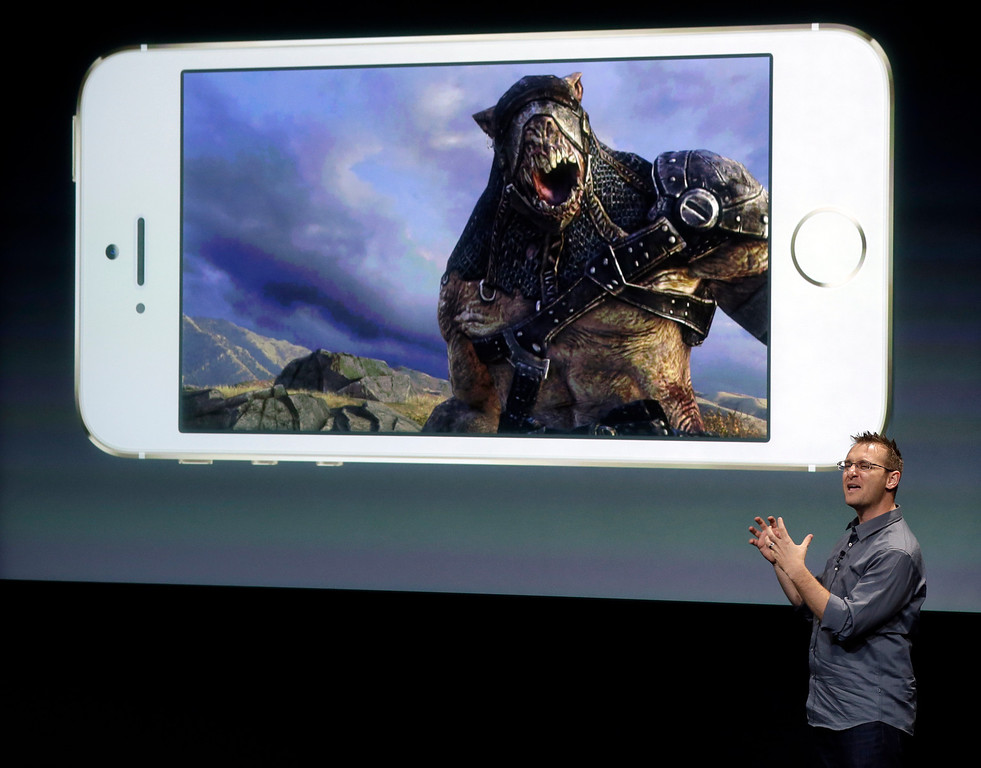 . Donald Mustard, CEO of Epic Games, speaks on stage during the introduction of the new iPhone 5s in Cupertino, Calif., Tuesday, Sept. 10, 2013. (AP Photo/Marcio Jose Sanchez)