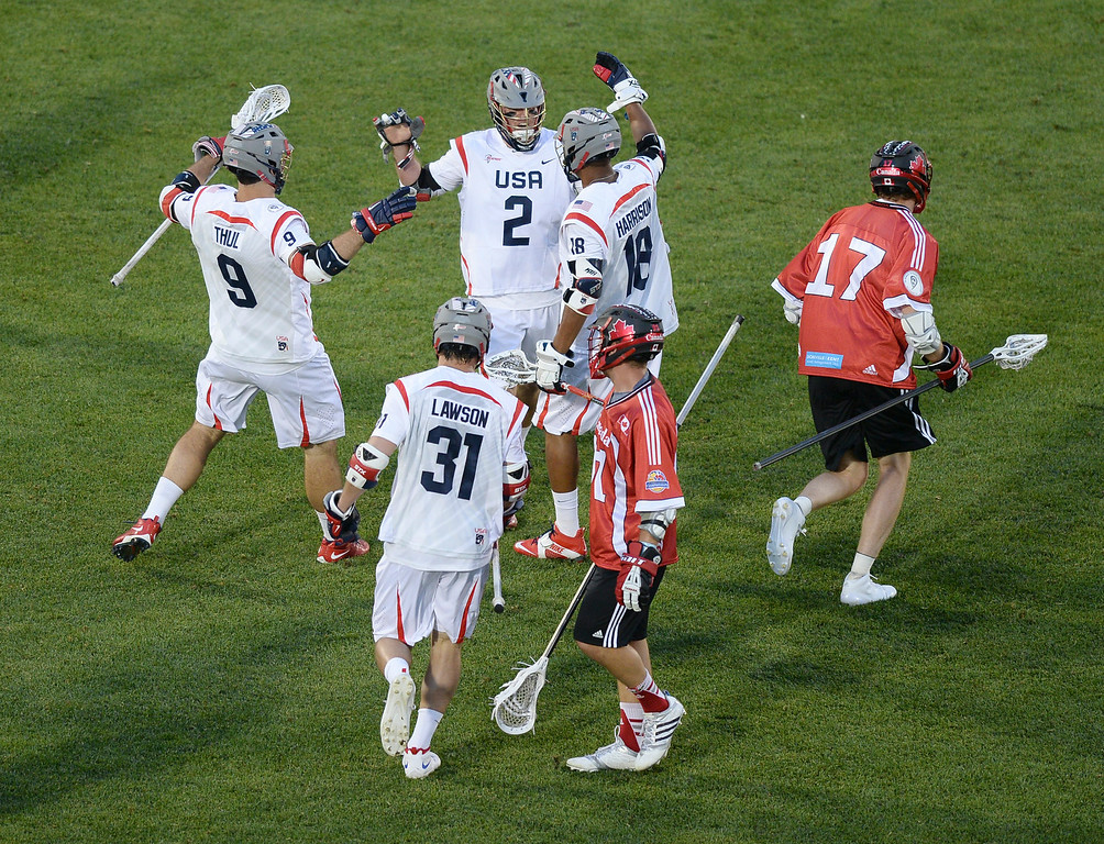 . American attack Brendan Mundorf (2) celebrated a goal in the second quarter. The United States took on Canada in the opening game of the FIL World Lacrosse Championships Thursday night, July 10, 2014.   Photo by Karl Gehring/The Denver Post