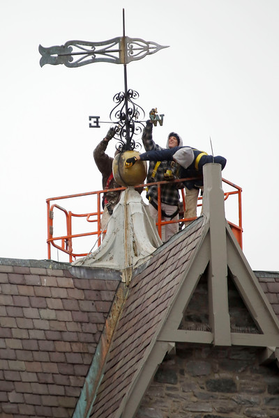 Painting weathervane atop First Church-103018