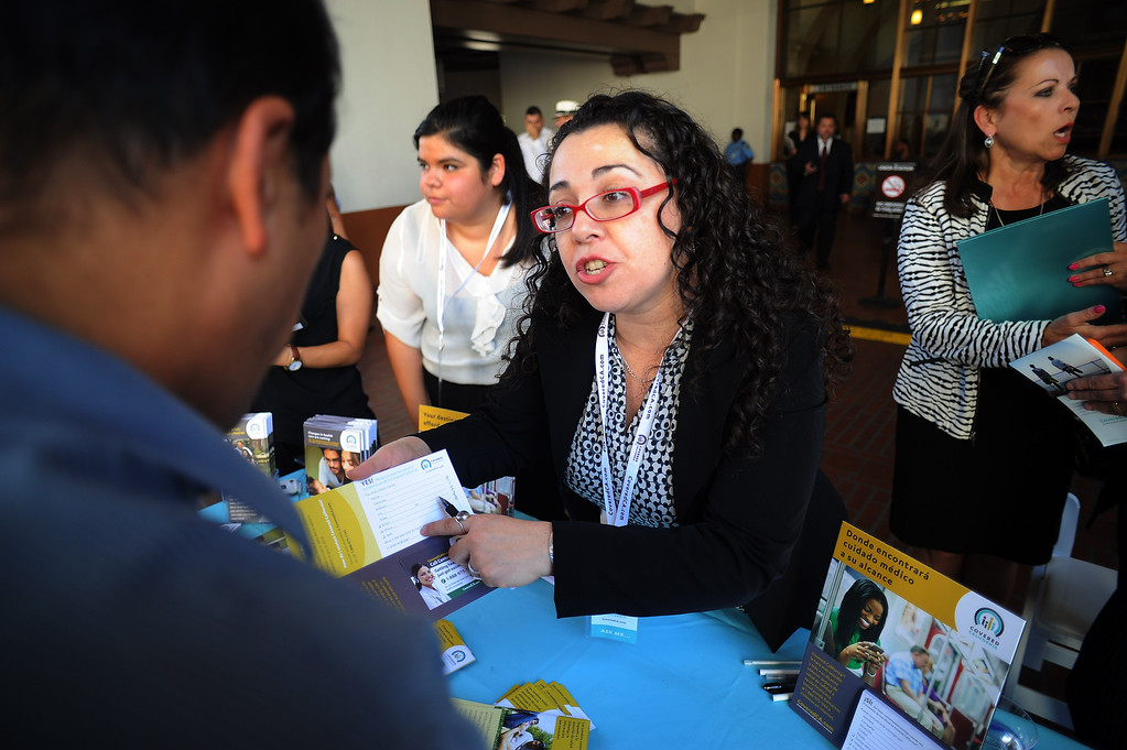 . Laura Palomare gives William Aragon information during a rally for Covered California, the state run market exchange for health care insurance at Union Station in Los Angeles Tuesday, October 1, 2013. The rally was held to help kick off open enrollment for those eligible uninsured who qualify to enroll in affordable health care.(Photo by Hans Gutknecht/Los angeles Daily News)