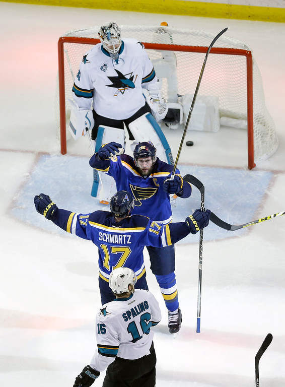 . St. Louis Blues center David Backes (42) celebrates with left wing Jaden Schwartz (17) after scoring a goal against San Jose Sharks goalie Martin Jones (31) during the first period in Game 1 of the NHL hockey Stanley Cup Western Conference finals, Sunday, May 15, 2016, in St. Louis. (AP Photo/Jeff Roberson)