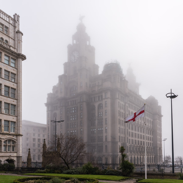 (Square) Royal Liver Building, Pier Head, Liverpool in the fog from the gardens of Our Lady and St Nicholas Church