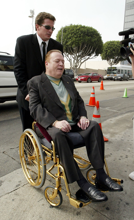 . LOS ANGELES - OCTOBER 7:  Gubernatorial candidate Larry Flynt, publisher of Hustler magazine, arrives in a gold wheelchair to vote in the recall election of Gov. Gray Davis October 7, 2003 in Los Angeles, California. Most recent polls show a majority of voters favoring the recall, though it was unclear how much Republican frontrunner Arnold Schwarzenegger would be hurt by allegations late in the campaign that he had groped women and once spoke admiringly of Adolph Hitler.  (Photo by David McNew/Getty Images)