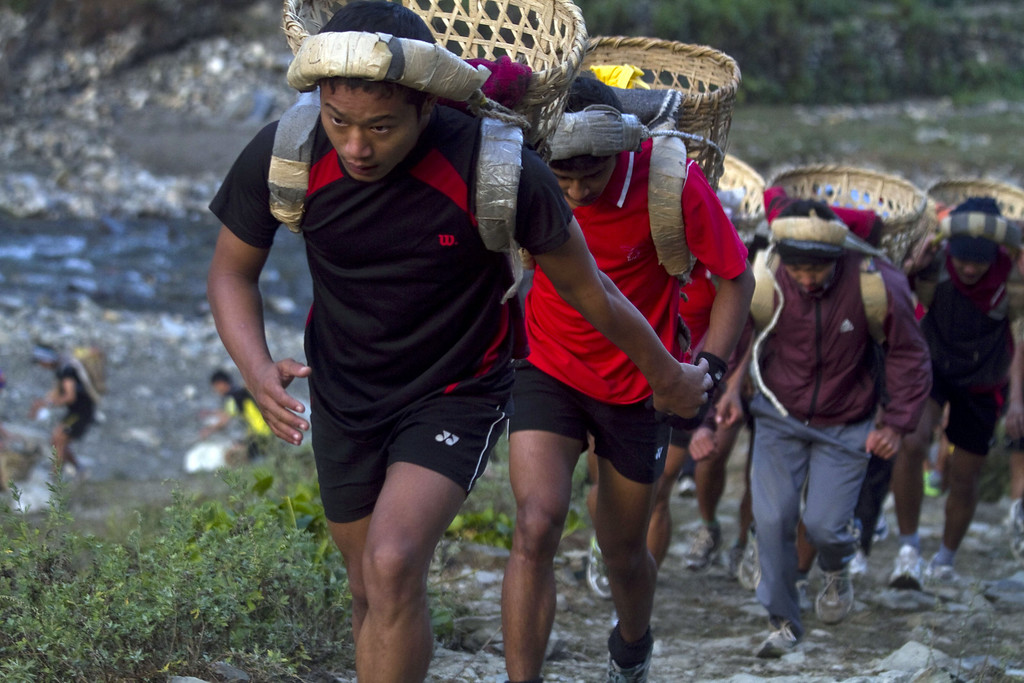 . Nepalese youths carry baskets locally known as \'Doko\' containing 25 kg of stones as part of a physical training session, organized by a private institute in Phokhara who prepares them for the British Gurkha soldier recruitment selection, at Malam Mountain in Kaski district, Nepal, 18 November 2012. The British Gurkha soldier recruitment selection process started on 23 November and runs untill the end of December 2012 at British Gurkha camp situated in Pokhara City, Nepal. Around 125 youths will be selected from more than three thousands participants. Those selected will join the British Army, a selection which carries much prestige and admiration throughout Nepalese society.  EPA/NARENDRA SHRESTHA