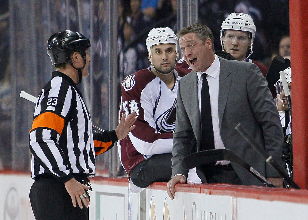 . Colorado Avalanche coach Patrick Roy argues a call with the referee during the second period of an NHL hockey game against the Winnipeg Jets on Wednesday, March 19, 2014, in Winnipeg, Manitoba. (AP Photo/The Canadian Press, John Woods)