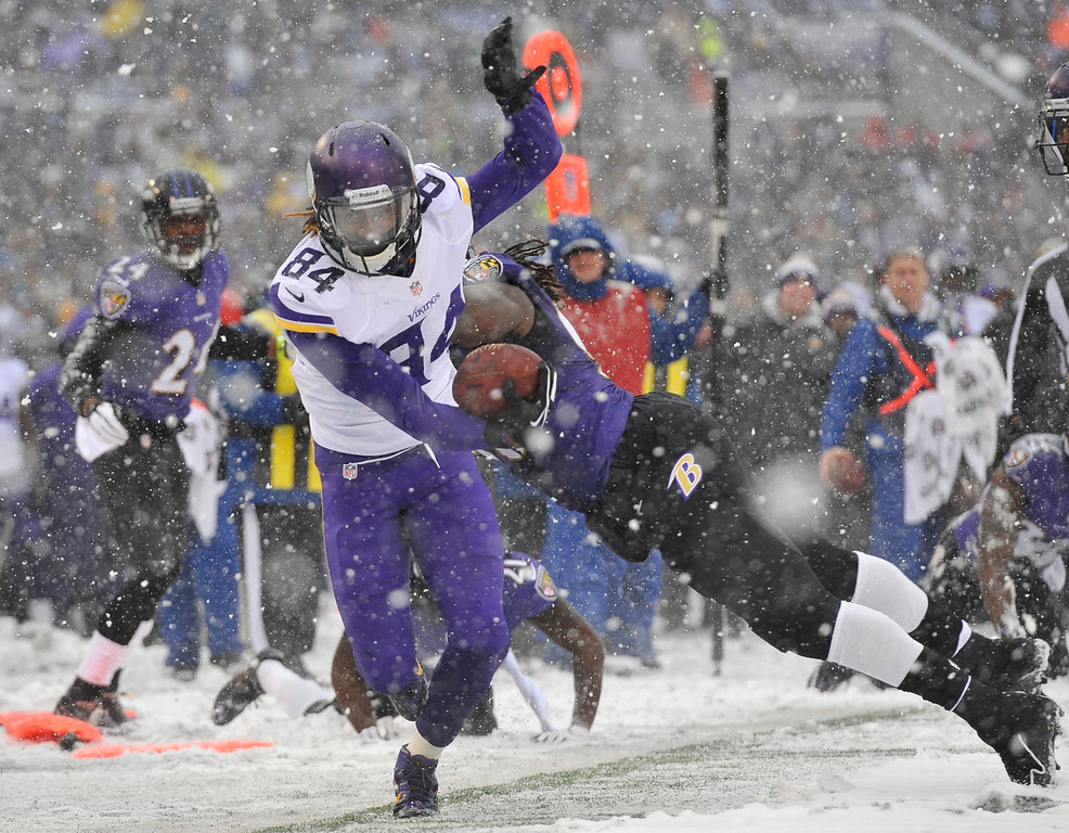 . Minnesota Vikings wide receiver Cordarrelle Patterson (84) tries to stay in bounds as he rushes the ball past Baltimore Ravens linebacker Pernell McPhee in the first half of an NFL football game on Sunday, Dec. 8, 2013, in Baltimore. (AP Photo/Gail Burton)