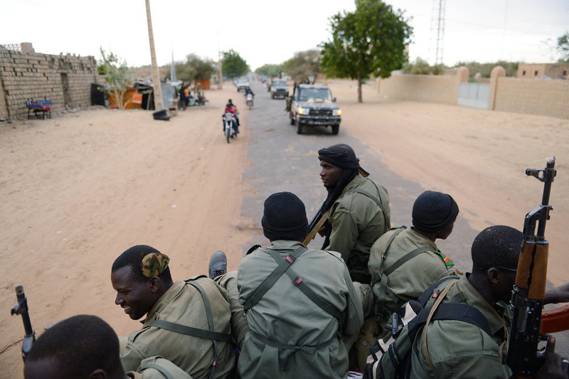 . Malian soldiers enter the historic city of Timbuktu, occupied for 10 months by Islamists who imposed a harsh form of sharia, on January 28, 2013. Hundreds of people scrambled Monday to give French-led troops a hero\'s welcome as they entered the city.    ERIC FEFERBERG/AFP/Getty Images