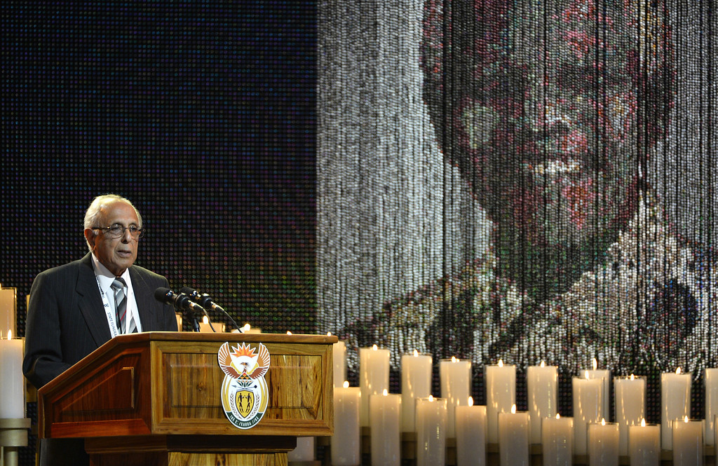 . FILE - In this Dec. 15, 2013 file photo, anti-apartheid activist and close friend of Nelson Mandela, Ahmed Kathrada, speaks during the funeral service for the former South African president in Qunu, South Africa. Kathrada died Tuesday, March 28, 2017, after a short illness at the age of 87. (AP Photo/Odd Andersen, Pool, File)