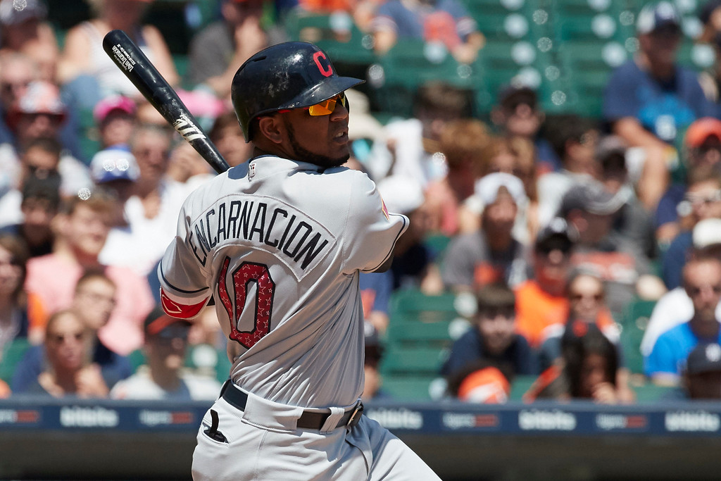 . Cleveland Indians\' Edwin Encarnacion hits an RBI-single against the Detroit Tigers in the fourth inning of a baseball game in Detroit, Sunday, July 2, 2017. (AP Photo/Rick Osentoski)
