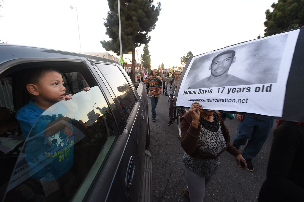. Protestors march November 25, 2014 in Los Angeles, one day after a grand jury decision not to prosecute a white police officer for the killing of an unarmed black teen in Ferguson, Missouri.    AFP PHOTO / Robyn  BECK/AFP/Getty Images