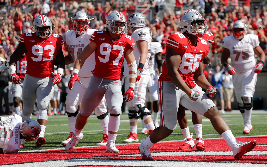 . Ohio State defensive lineman Dre\'Mont Jones, right, celebrates tackling UNLV running back Lexington Thomas, left, for a safety during the first half of an NCAA college football game Saturday, Sept. 23, 2017, in Columbus, Ohio. (AP Photo/Jay LaPrete)