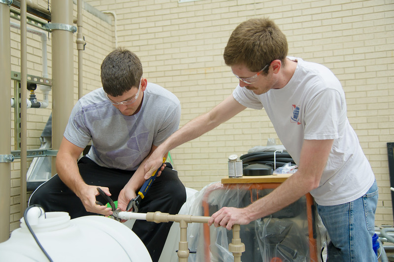 Students David Trudeau(left) and Ian T. Gates work together finishing their Engineering Capstone project.