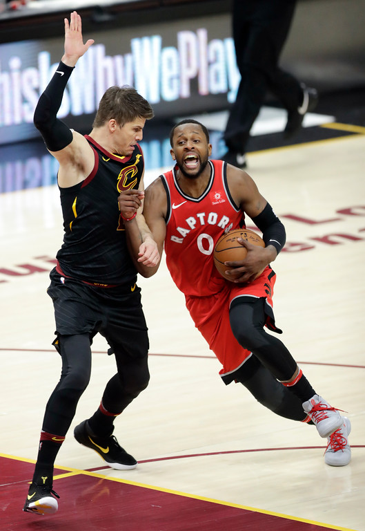 . Toronto Raptors\' CJ Miles (0) drives on Cleveland Cavaliers\' Kyle Korver in the second half of Game 4 of an NBA basketball second-round playoff series, Monday, May 7, 2018, in Cleveland. (AP Photo/Tony Dejak)