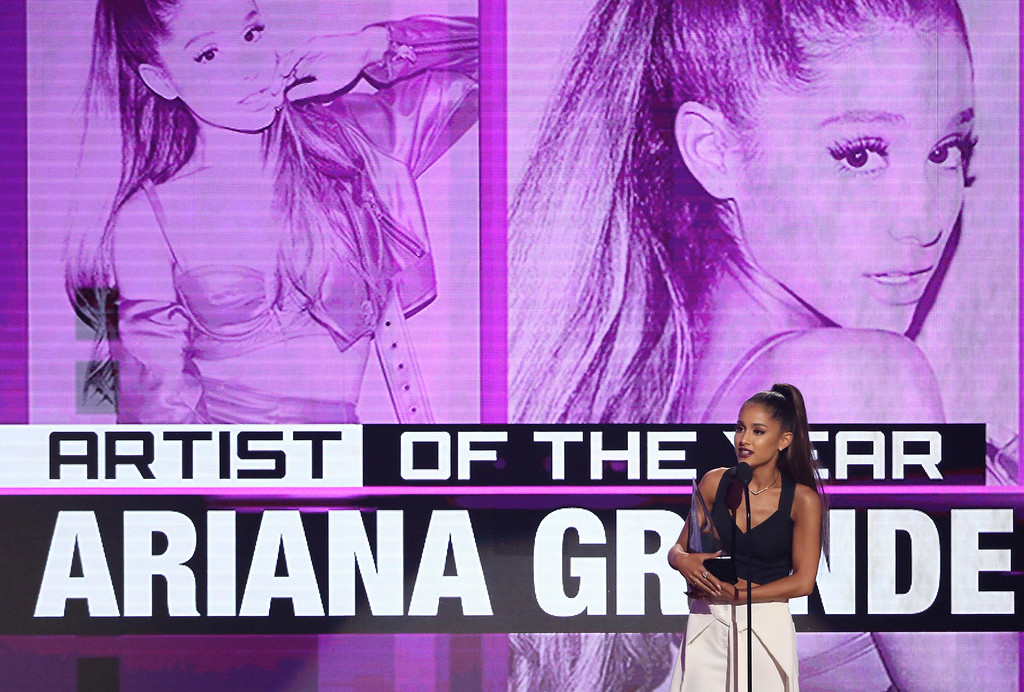 . Ariana Grande accepts the award for artist of the year at the American Music Awards at the Microsoft Theater on Sunday, Nov. 20, 2016, in Los Angeles. (Photo by Matt Sayles/Invision/AP)