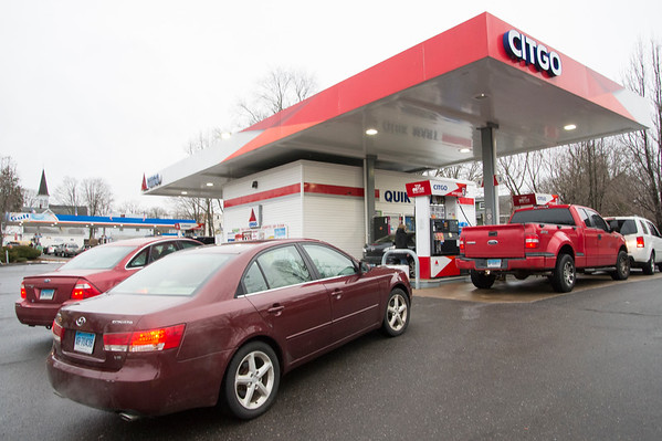02/10/20 Wesley Bunnell | StaffrrCars lined up to take advantage of sub two dollar a gallon regular gas prices at the Gulf and CITGO Stations on Main St in the Terryville section of Plymouth. Cars wait in line for gas at the CITGO station.