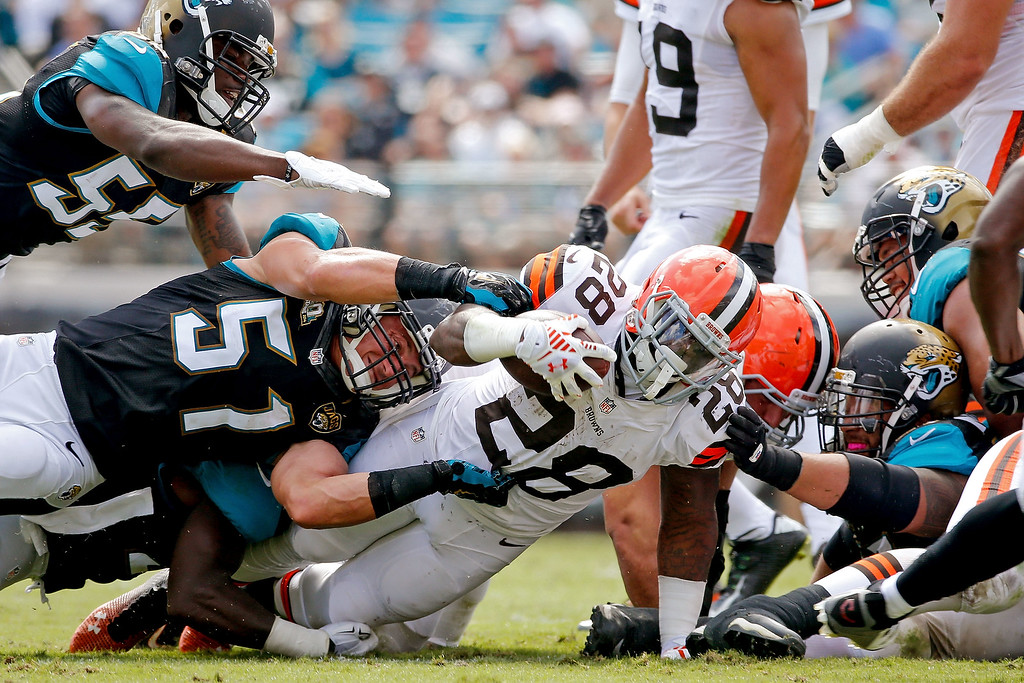 . Terrance West #28 of the Cleveland Browns is stopped by Paul Posluszny #51 of the Jacksonville Jaguars during the second quarter of the game at EverBank Field on October 19, 2014 in Jacksonville, Florida.  (Photo by Rob Foldy/Getty Images)