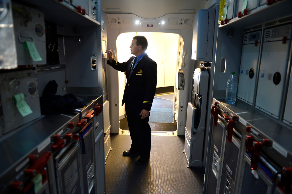 . International Service Manager Rob Jaggard is framed by the galley while preparing a Boeing 787 Dreamliner for departure for Houston at Denver International Airport in Denver, CO May 21, 2013.  (Photo By Craig F. Walker/The Denver Post)