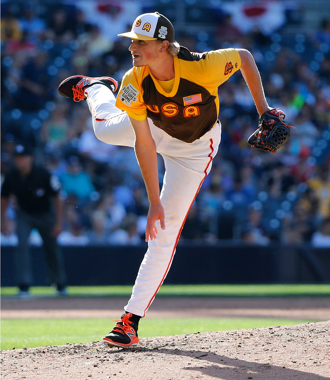. U.S. Team\'s Phil Bickford, of the San Francisco Giants, throws against the World Team during the sixth inning of the All-Star Futures baseball game, Sunday, July 10, 2016, in San Diego. (AP Photo/Lenny Ignelzi)