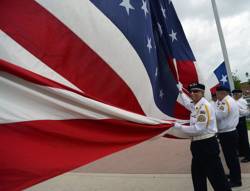 . Members of the American Legion Post in Brownsville, Texas, prepare for the Memorial Day ceremonies began at Veterans Memorial Park, Monday, May 26, 2014. (AP Photo/The Brownsville Herald, Brad Doherty)