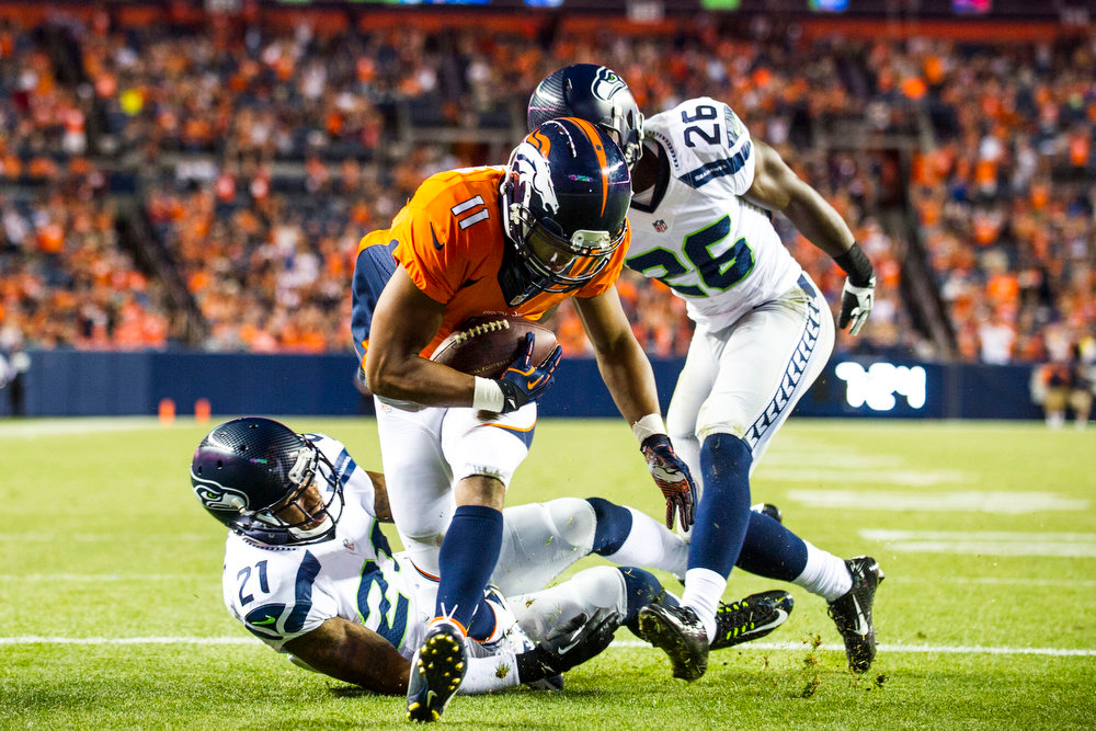 . Jordan Norwood (11) wide receiver of the Denver Broncos runs in for a touchdown during a preseason game between the Denver Broncos and the Seattle Seahawks at Sports Authority Field at Mile High on Thursday, August 07, 2014 in Denver, Colorado.  (Photo by Kent Nishimura/The Denver Post)