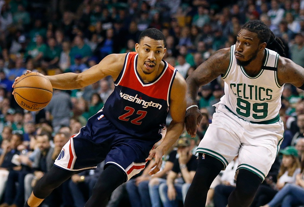 . Washington Wizards\' Otto Porter Jr. (22) drives past Boston Celtics\' Jae Crowder (99) during the third quarter of a second-round NBA playoff series basketball game, Sunday, April, 30, 2017, in Boston. The Celtics won 123-111. (AP Photo/Michael Dwyer)