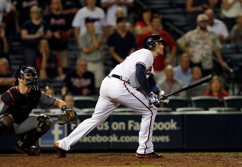 . Atlanta Braves first baseman Freddie Freeman (5) follows through with a game-winning base hit in the 10th inning of a baseball game against the Minnesota Twins Tuesday, May 21, 2013 in  in Atlanta. (AP Photo/John Bazemore)