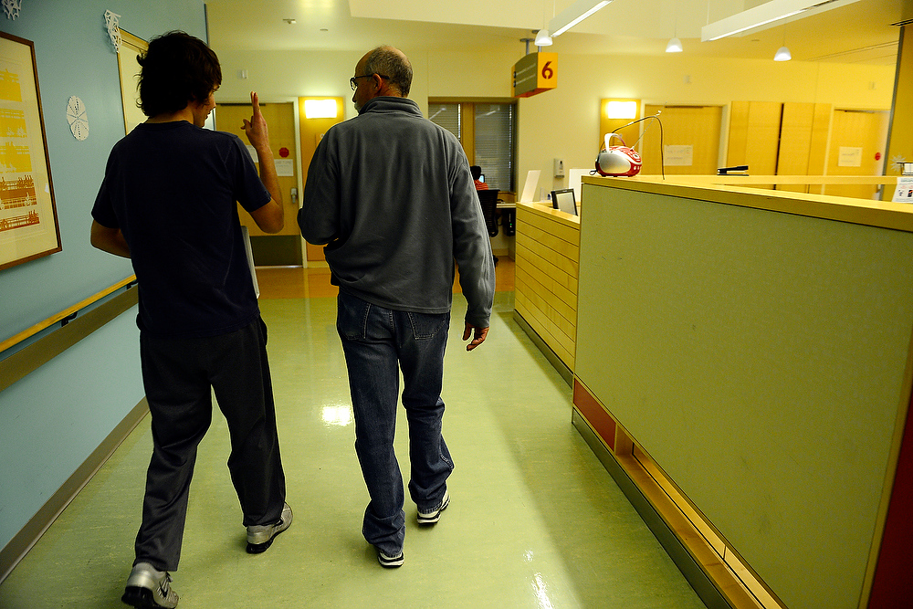 . Trey walks with his father Mike back to his room. Mike asked if Trey could remember where it was -- Trey responded incorrectly as a joke on his father. AAron Ontiveroz, The Denver Post