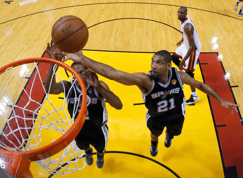 . San Antonio Spurs power forward Tim Duncan (21) pulls down a rebound against the Miami Heat during Game 6 of their NBA Finals basketball playoff in Miami, Florida June 18, 2013. REUTERS/Kevin C. Cox/Pool