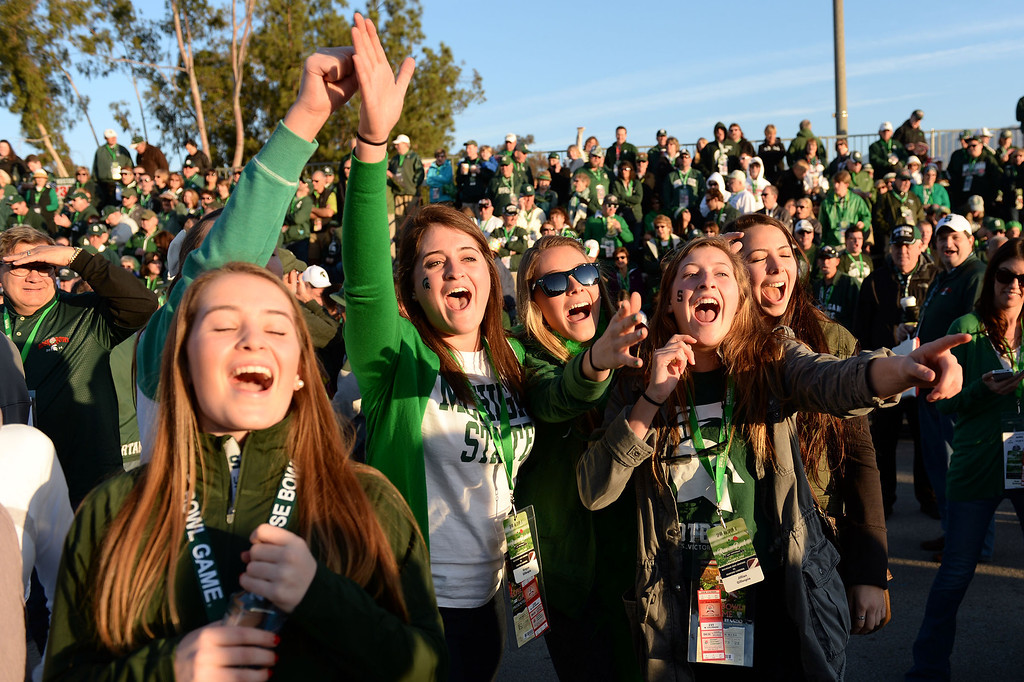 . Michigan State fans cheer during the 2014 Rose Parade in Pasadena, CA January 1, 2014.(Keith Durflinger/San Gabriel Valley Tribune)