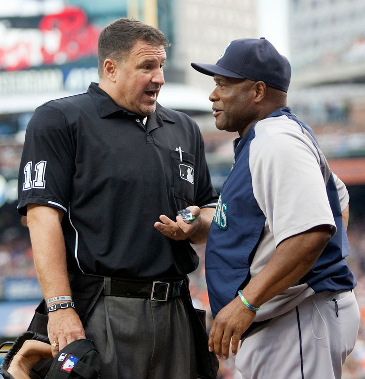 . Seattle Mariners manager Lloyd McClendon, right, talks with home plate umpire Tony Randazzo in the first inning of a baseball game against the Detroit Tigers, Saturday, Aug. 16, 2014, in Detroit. McClendon was unhappy when a timeout was called in the middle of the windup of Mariners pitcher Felix Hernandez. (AP Photo/Duane Burleson)