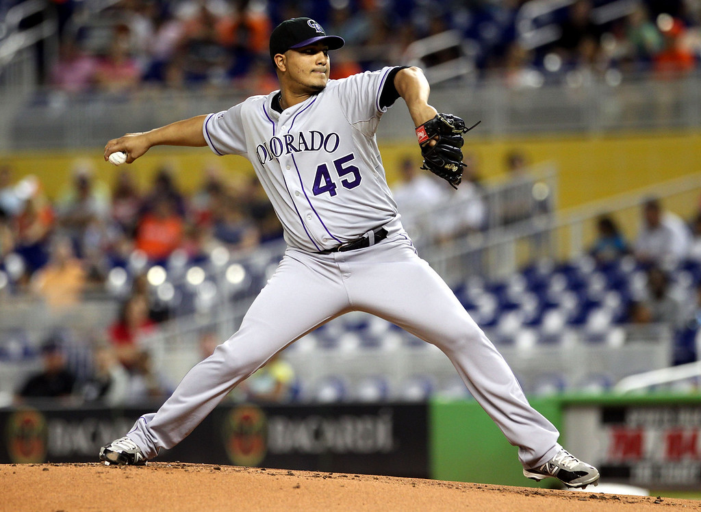 . MIAMI, FL - AUGUST 23:  Pitcher Jhoulys Chacin #45 of the Colorado Rockies throws against the Miami Marlins at Marlins Park on August 23, 2013 in Miami, Florida.  (Photo by Marc Serota/Getty Images)