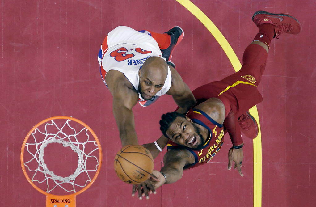 . Cleveland Cavaliers\' Jae Crowder, right, drives to the basket against Detroit Pistons\' Anthony Tolliver in the first half of an NBA basketball game, Sunday, Jan. 28, 2018, in Cleveland. The Cavaliers won 121-104. (AP Photo/Tony Dejak)