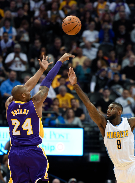 . DENVER, CO - MARCH 02: Los Angeles Lakers forward Kobe Bryant (24) takes a shot over Denver Nuggets guard JaKarr Sampson (9) March 2, 2016 at Pepsi Center. This is Kobe\'s last game in Denver as he retires at the end of the season. (Photo By John Leyba/The Denver Post)