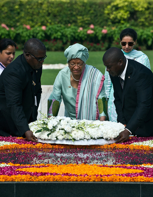 . President of the Republic of Liberia Ellen Johnson-Sirleaf lays a wreath at Rajghat, memorial for Mahatma Gandhi, during a visit in New Delhi on September 11, 2013.  Johnson-Sirleaf is in India for a five-day state visit.  PRAKASH SINGH/AFP/Getty Images