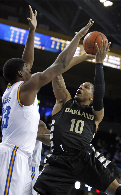 . Oakland guard Duke Mondy (10) shoots over UCLA center Tony Parker (23) defending in the first half of their NCAA college basketball game Tuesday, Nov. 12, 2013, in Los Angeles. (AP Photo/Alex Gallardo)