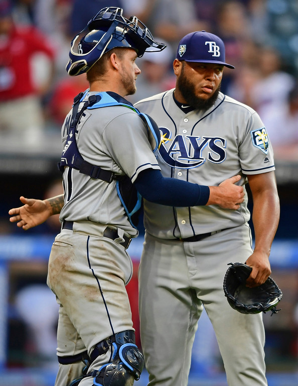 . Tampa Bay Rays relief pitcher Jose Alvarado, right, is congratulated by catcher Adam Moore after defeating the Cleveland Indians in a baseball game, Sunday, Sept. 2, 2018, in Cleveland. (AP Photo/David Dermer)