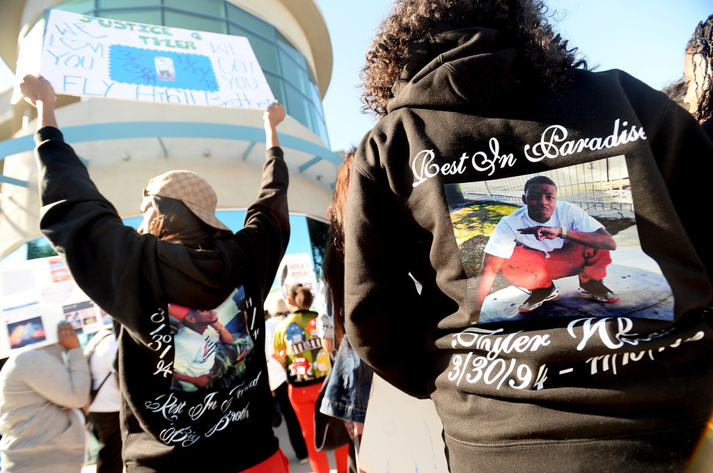 . Community members, friends and family of Tyler Woods, who was shot by the Long Beach Police Department on Nov. 19, protested the shooting death with a march to the police department headquarters in Long Beach on Sunday, November 24, 2013. (Photo by Sean Hiller/ Daily Breeze).