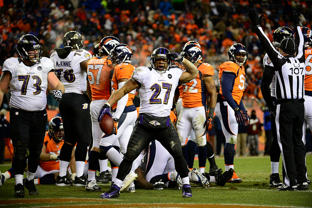 . Baltimore Ravens running back Ray Rice (27) runs up the middle for a touchdown in the third quarter. The Denver Broncos vs Baltimore Ravens AFC Divisional playoff game at Sports Authority Field Saturday January 12, 2013. (Photo by AAron  Ontiveroz,/The Denver Post)