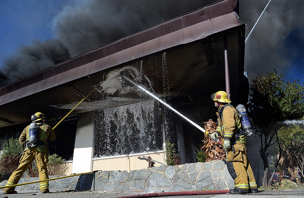 . More than 20 fire units, from at least five agencies, fight a third-alarm fire Tuesday December 31, 2013 at an abandoned bowling alley, once known as the San-Hi Lanes, in San Bernardino on the corner of Western Avenue and Highland Avenue. (Staff photo by Rick Sforza/The Sun)