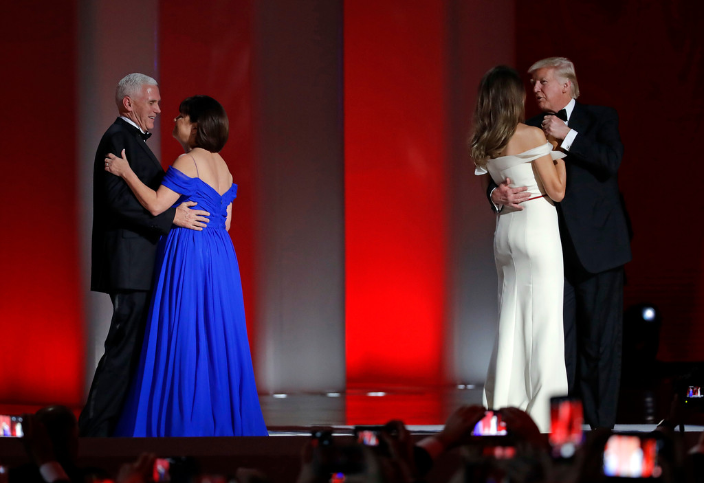 . President Donald Trump, right, dances with first lady Melania Trump as Vice President Mike Pence dances with his wife Karen Pence at the Liberty Ball, Friday, Jan. 20, 2017, in Washington. (AP Photo/Patrick Semansky)